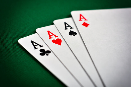 Four aces, including spades, hearts, clubs and diamonds